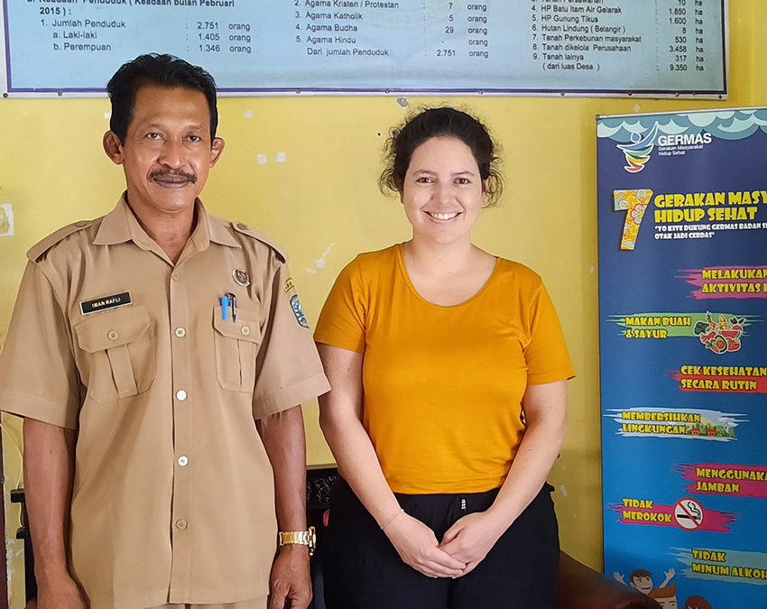 Diana Almeida and a local man dressed in a uniform. Photo.