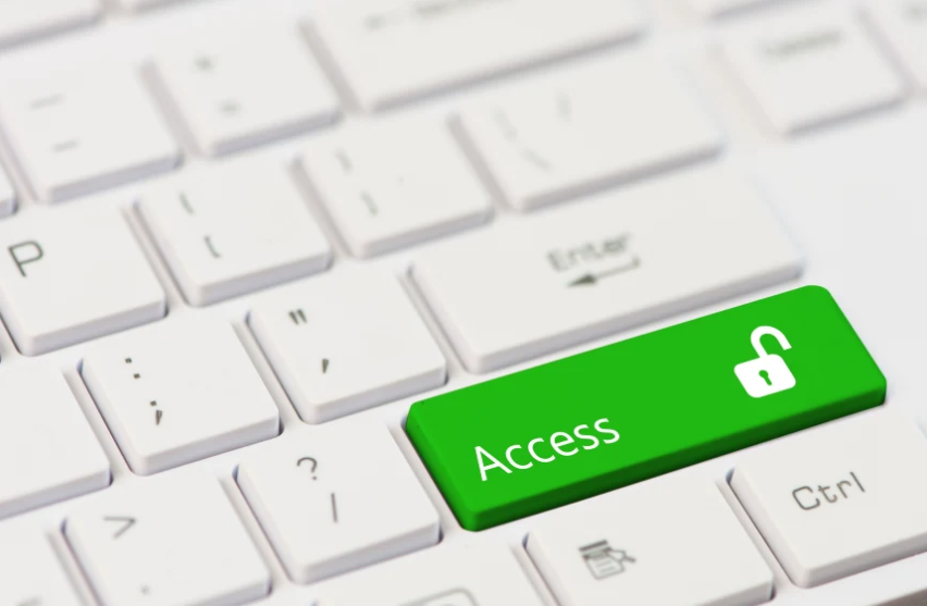 Close up of white keyboard with a green button for Access Illustration by Shutterstock