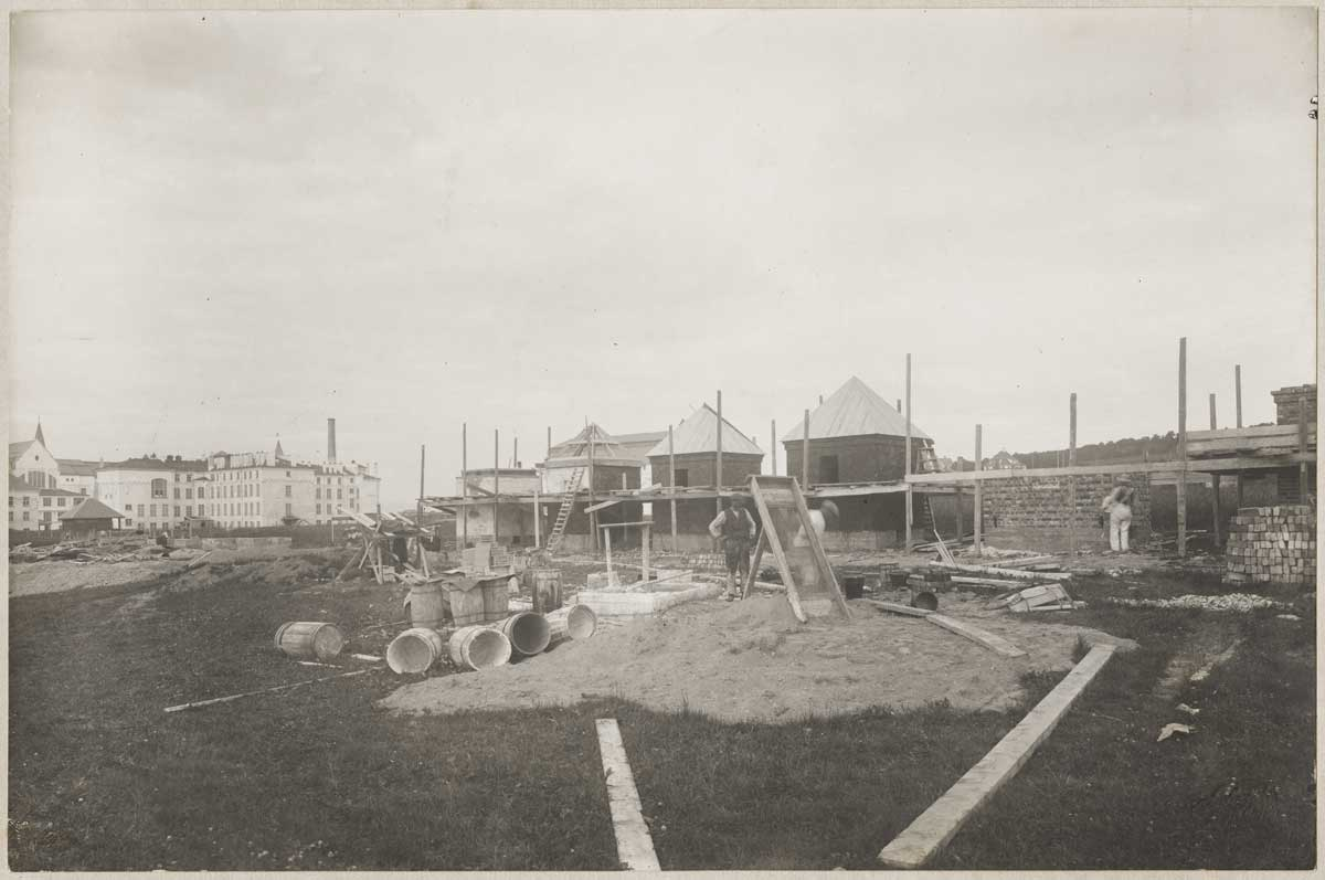 Photograph showing test houses under construction.