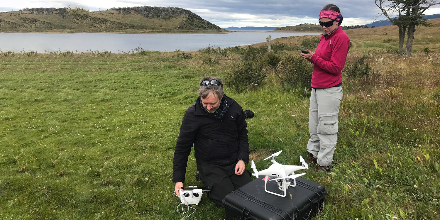 Two researchers with drones.