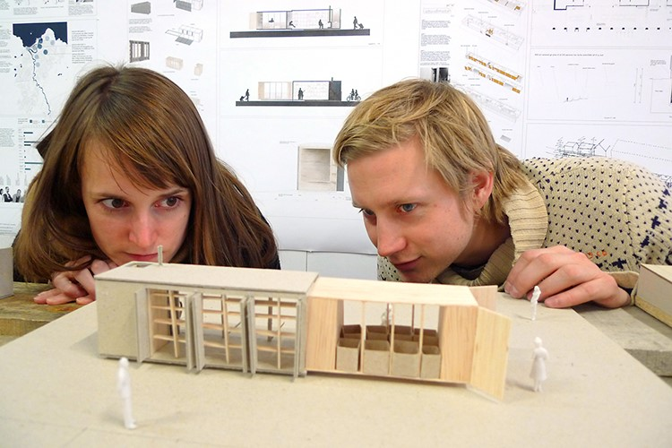 Illustration image with female and male architecture student looking at a miniature model in wood.