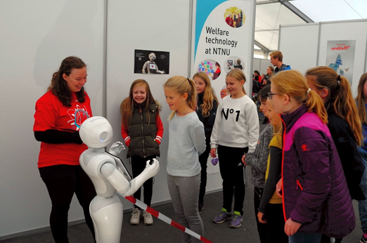 Picture of kids meeting a robot.